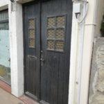 Ancienne porte d'accès de la boutique avant son changement